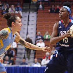 Atlanta's Tiffany Hayes (15) is guarded by Chicago's Jacki Gemelos (5).