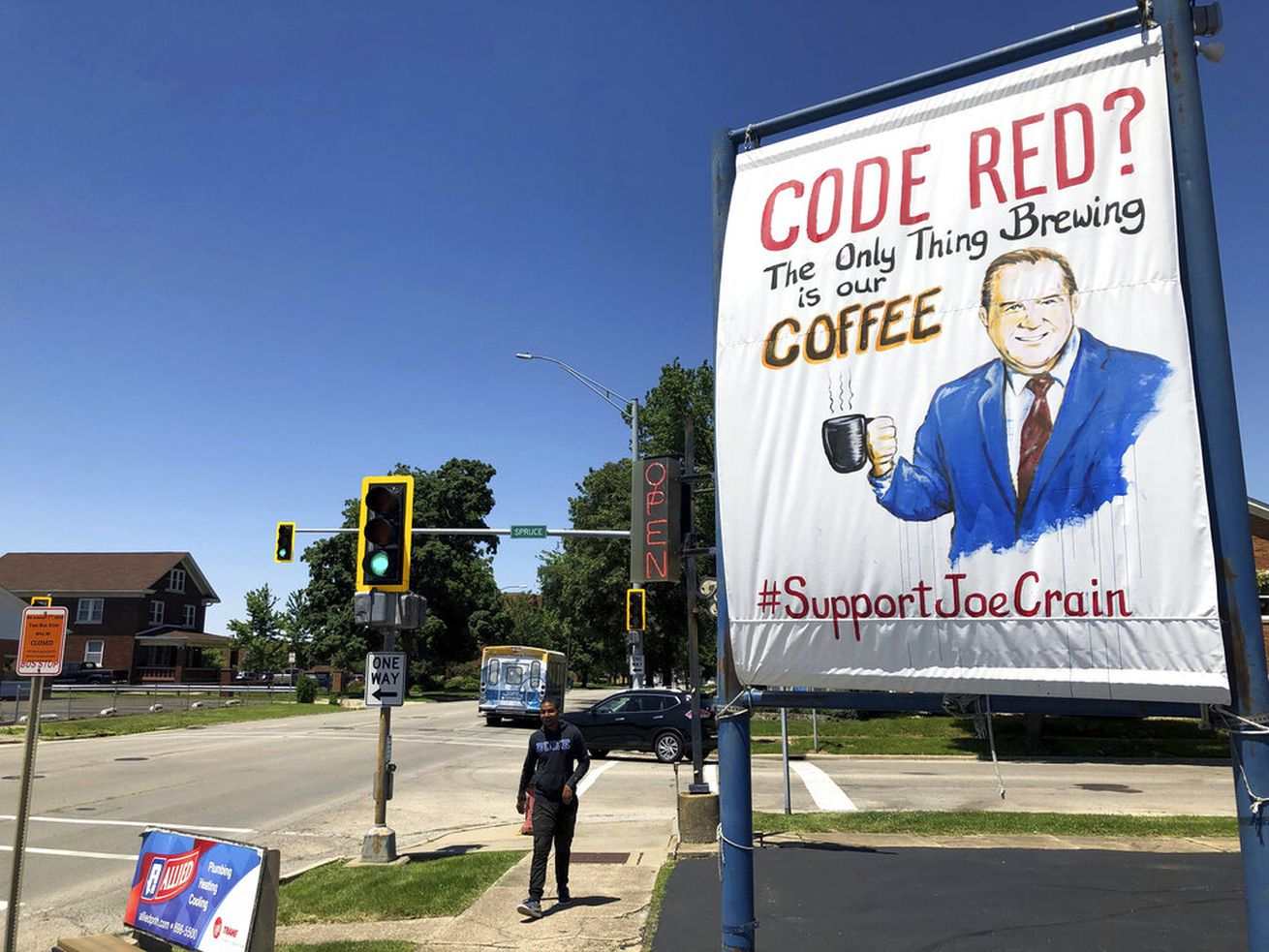A sign supporting Springfield meteorologist Joe Crain appears at Grab a Java, a drive-through coffee joint, on Monday, June 10, 2019 in Springfield, Ill. The central Illinois city is defending a popular meteorologist who has been absent from local television newscasts since he criticized a corporate weather-alert brand.