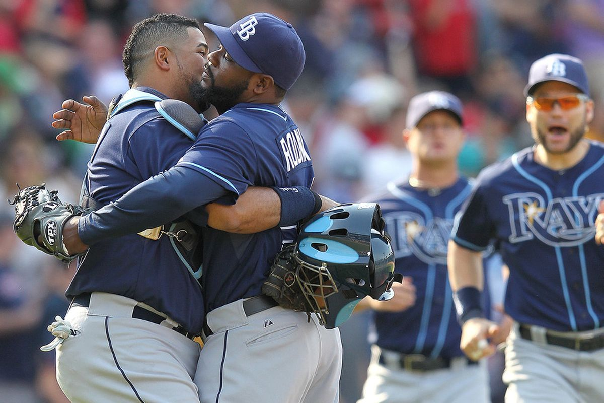 BOSTON, MA - MAY 27:  Jose Molina #28 of the Tampa Bay Rays and teammate Fernando Rodney #56 celebrate a 4-3 win against the Boston Red Sox in the eighth inning at Fenway Park May 27, 2012  in Boston, Massachusetts. (Photo by Jim Rogash/Getty Images)