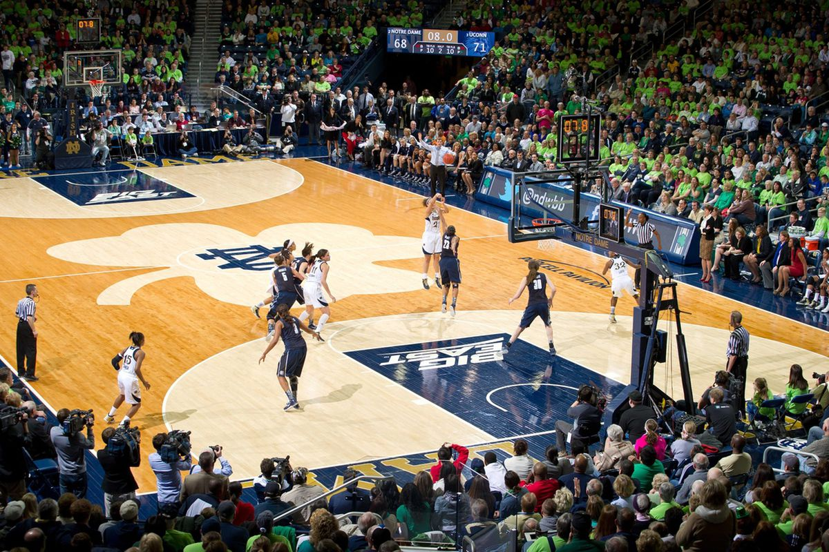 Notre Dame Fighting Irish guard Kayla McBride (21) shoots a three point basket over Connecticut Huskies forward Kaleena Mosqueda-Lewis at the end of the first overtime period, which forced a second overtime..