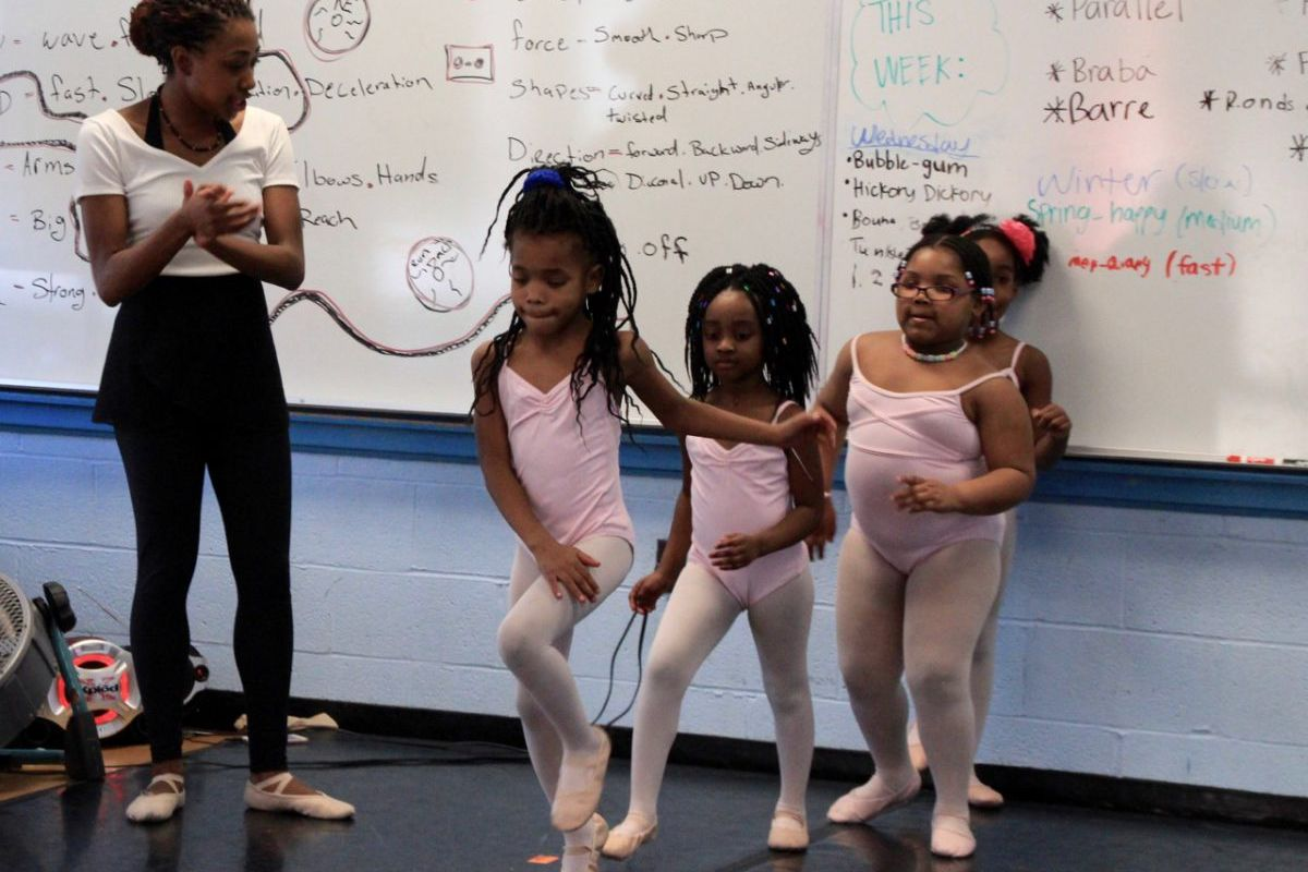 Briana Brown, an instructor with New Ballet Ensemble, prepares her first-grade dance students for a performance at Dunbar Elementary School in Memphis.