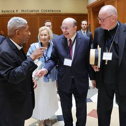 Elder Quentin L. Cook of The Church of Jesus Christ of Latter-day Saints' Quorum of the Twelve Apostles, and his wife, Sister Mary Cook, laugh with Reverend Eugene Rivers, left, and Cardinal Timothy Dolan, archbishop of New York, during the Notre Dame Religious Liberty Summit at the University of Notre Dame in South Bend, Ind., on Monday, June 28, 2021.