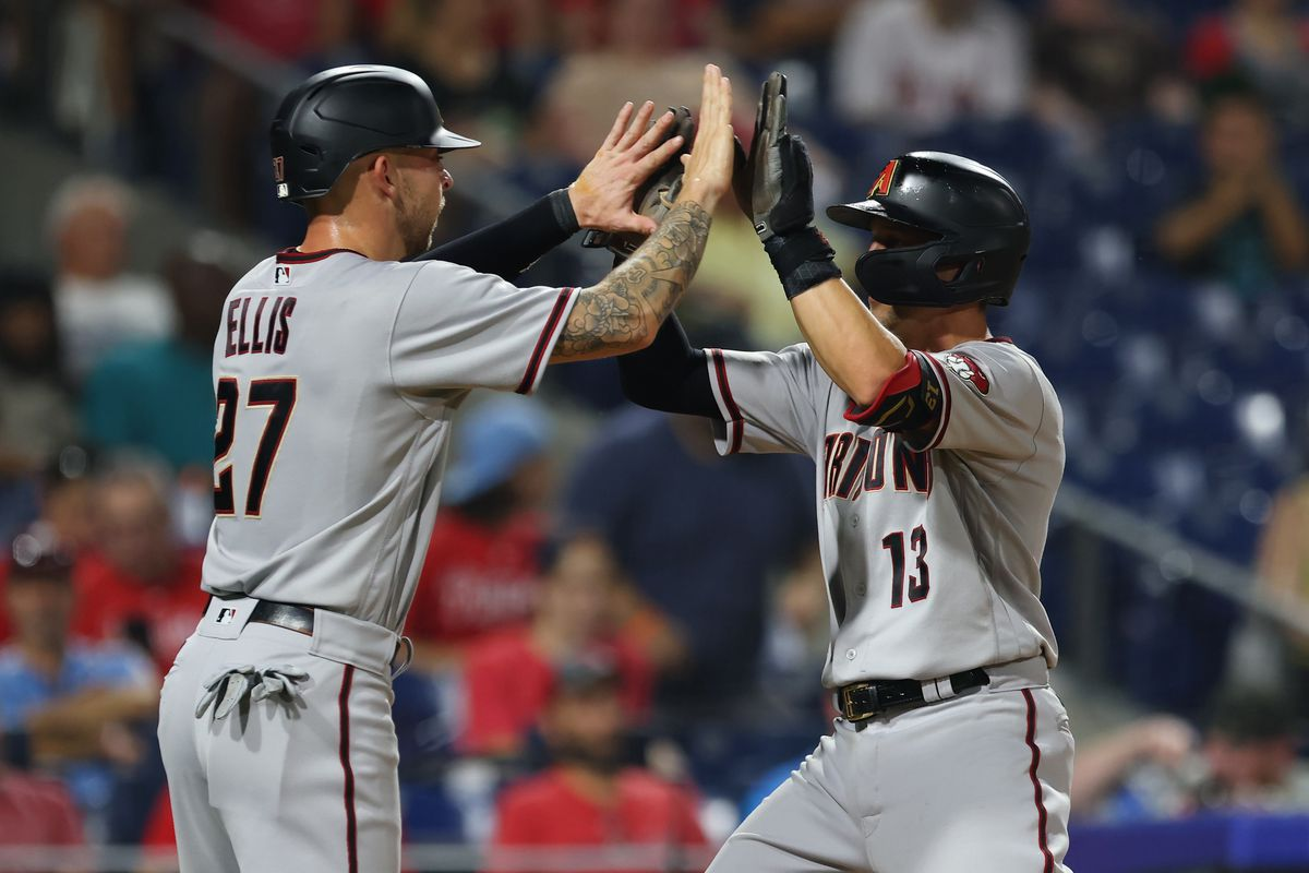 Nick Ahmed #13 of the Arizona Diamondbacks is congratulated by Drew Ellis #27 after he hit a two-run home run against the Philadelphia Phillies