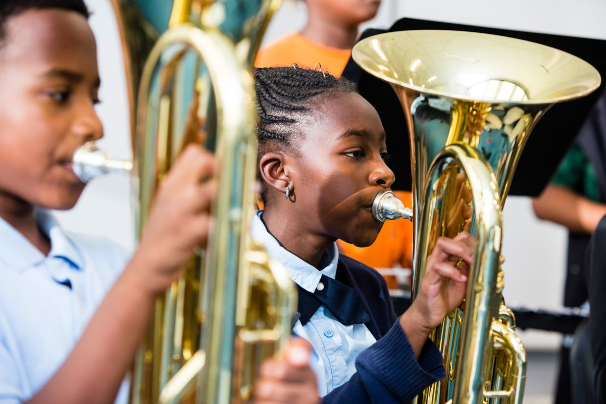 Students participate in band practice at The People's Music School, inside the Bronzeville Classical School on Sept. 24.