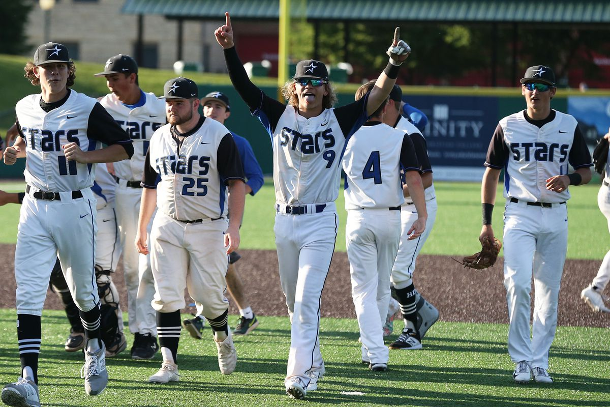 St. Charles North's Kyler Brown (9) celebrates the North Stars' 6-4 4A state semifinal victory over St. Rita.