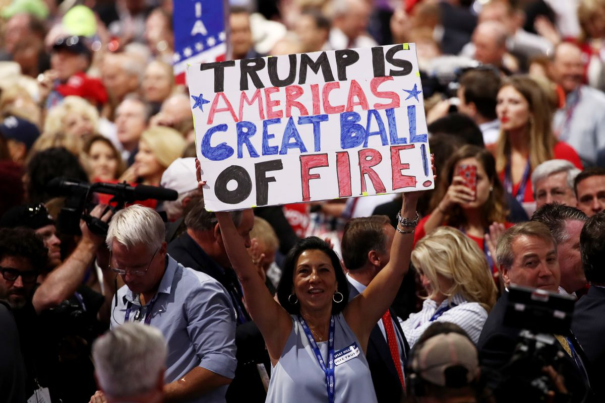 """Sign reads """"Trump is America's Great Ball of Fire"""""""