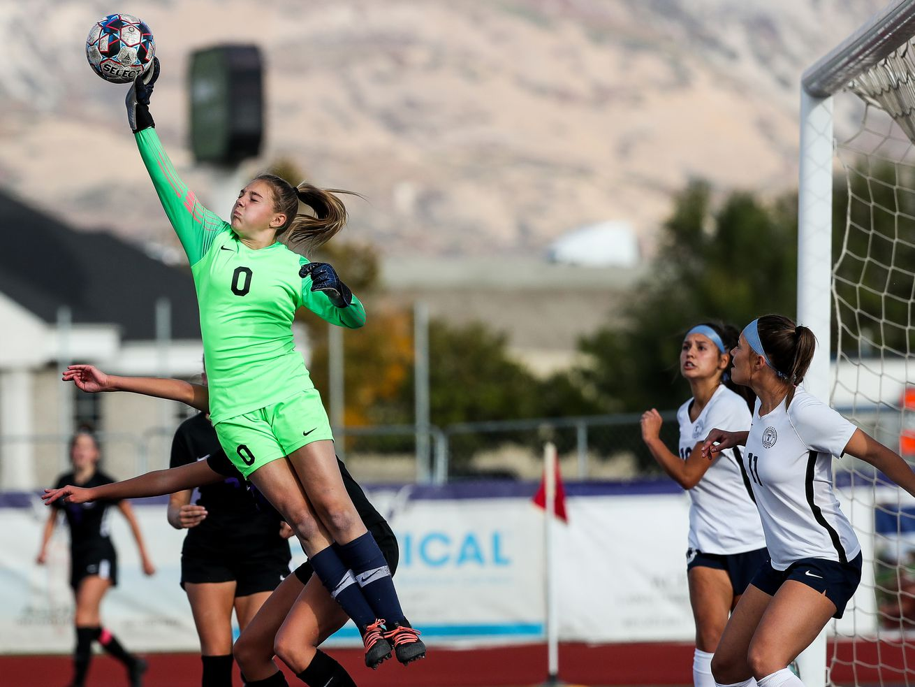Timpanogos goalkeeper Emma McIff makes a save after a corner kick in a 5A girls soccer game against Lehi in Lehi on Tuesday, Oct. 13, 2020.