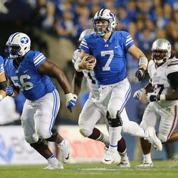 Brigham Young Cougars quarterback Taysom Hill (7) runs in the open field as BYU and Mississippi State play in Provo at LaVell Edwards Stadium on Friday, Oct. 14, 2016.