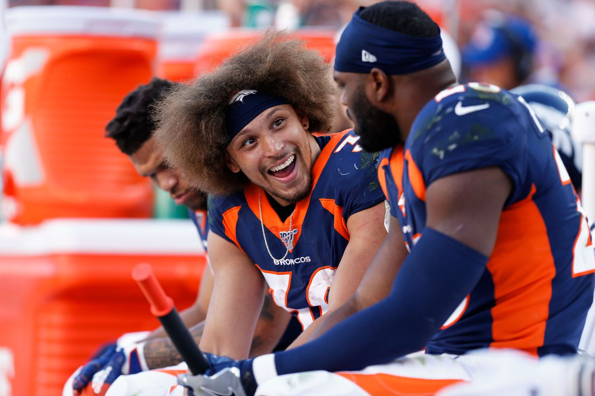 Denver Broncos running back Phillip Lindsay talks with running back Royce Freeman on the bench in the fourth quarter against the Tennessee Titans at Empower Field at Mile High.