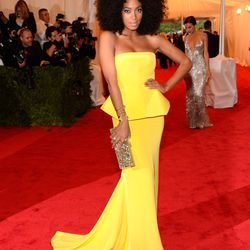 Solange Knowles in Rachel Roy, Sergio Rossi heels, an Edie Parker clutch, and Jennifer Fisher jewels in 2012.
