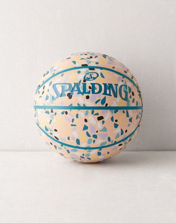 A Spalding basketball covered in a terrazzo pattern.