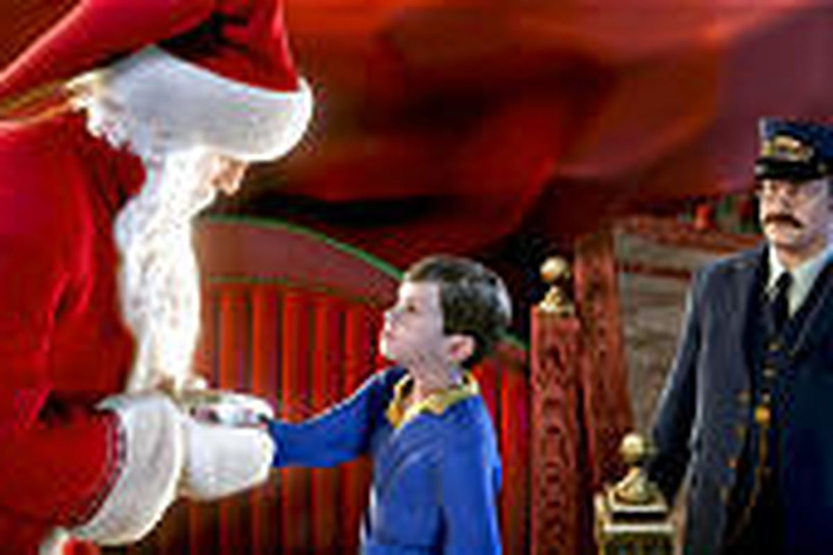 """Tom Hanks voices several characters, including the conductor, right, who also looks like him, in """"The Polar Express,"""" now on DVD."""