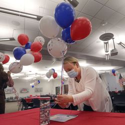 Abby Evans, Utah Republican Party data director, ties balloons at a Republican election night event at the Utah Association of Realtors building in Sandy on Tuesday, Nov. 3, 2020. Kendra Seeley, Utah Republican Party secretary, is on the left.