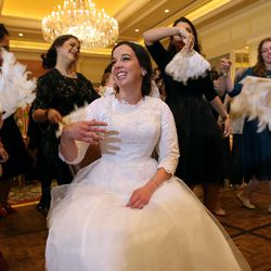 Female guests fan Chaya Zippel during her and Rabbi Mendy Cohen's traditional Chabad Lubavitch Jewish wedding at the Grand America Hotel in Salt Lake City on Monday, Sept. 12, 2016.