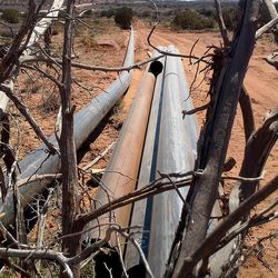 Sections of a pipeline to collect natural gas sit outside Dead Horse State Park near Moab, where oil development is creating conflict with environmentalists.