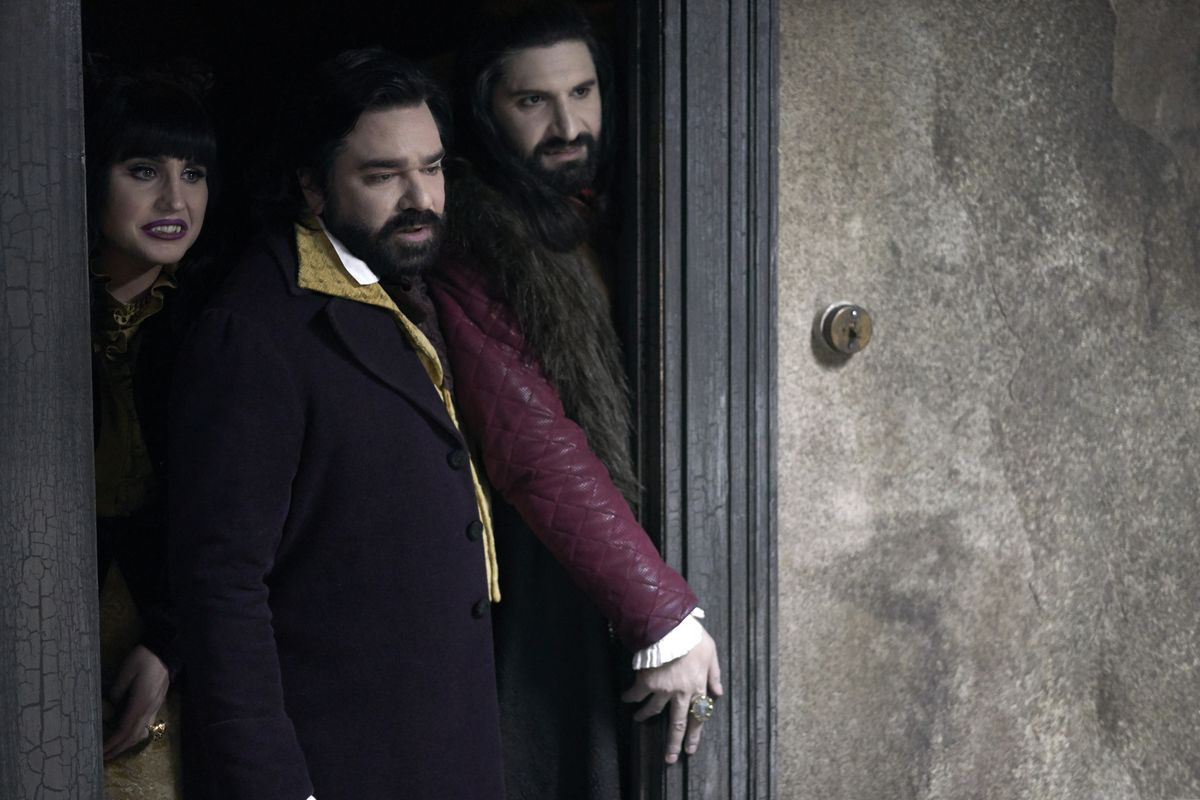 The three vampires from What We Do in the Shadows try to enter Colin's room.