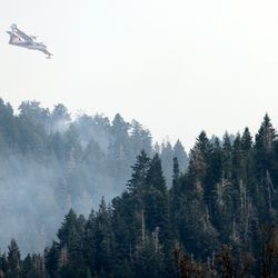 A water tanker begins a run to drop water as crews continue fighting the Parleys Canyon Fire near Park City on Sunday, Aug. 15, 2021.