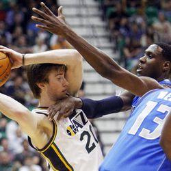 Utah Jazz guard Gordon Hayward (20) gets hit in the throat by Dallas Mavericks center Ian Mahinmi (28) as the Utah Jazz and the Dallas Mavericks play Monday, April 16, 2012 in Salt Lake City.