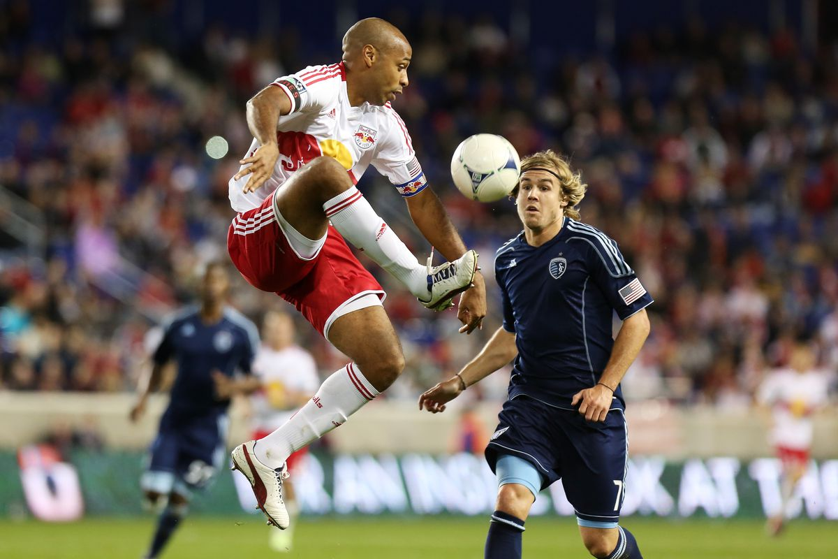 Chance Myers (right) and the rest of Sporting KC's defense were able to hold off a potent New York attack led by Thierry Henry (left)