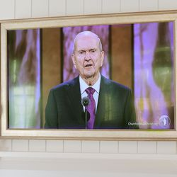 President Russell M. Nelson is pictured on a television in the home of Thomas and Mandi Godfrey, of Holladay, during the morning session of the 191st Annual General Conference of The Church of Jesus Christ of Latter-day Saints on Saturday, April 3, 2021.