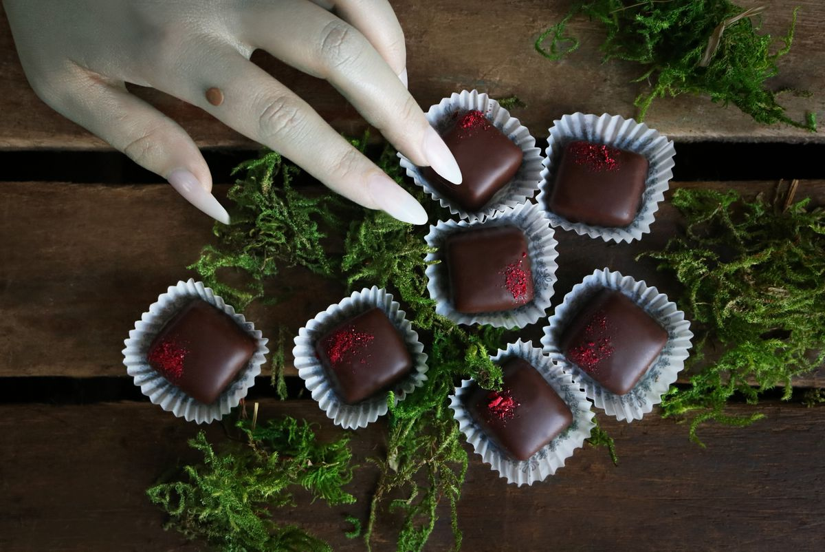 chocolate truffles and witches hand