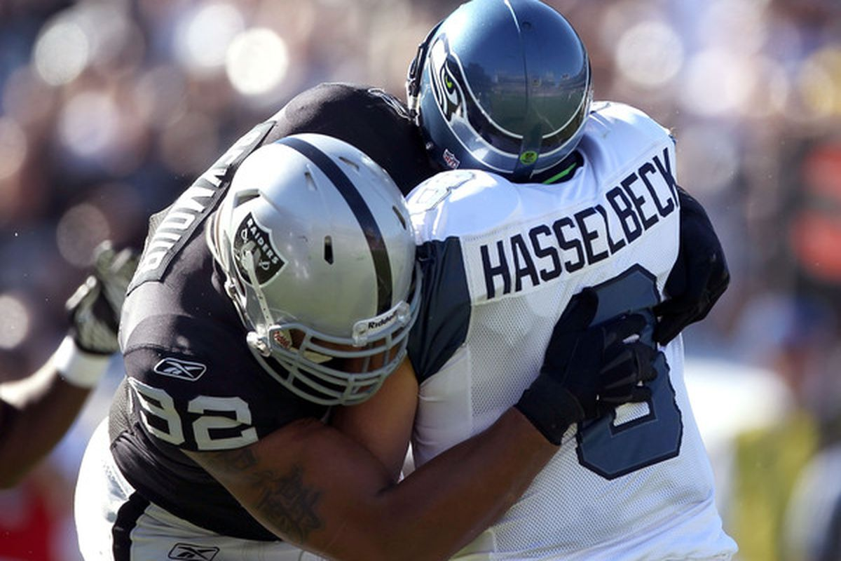 OAKLAND CA - OCTOBER 31:  Matt Hasselbeck #8 of the Seattle Seahawks is tackled by Richard Seymour #92 of the Oakland Raiders at Oakland-Alameda County Coliseum on October 31 2010 in Oakland California.  (Photo by Ezra Shaw/Getty Images)