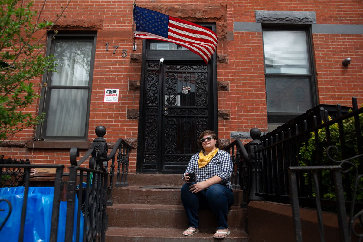 Meghan Daly relaxes on her Gowanus, Brooklyn stoop after being laid off during the coronavirus epidemic.