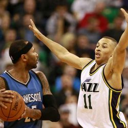 Utah Jazz guard Dante Exum guards Minnesota Timberwolves guard Mo Williams during the game in the Energy Solutions Arena Tuesday, Dec. 30, 2014, in Salt Lake City.