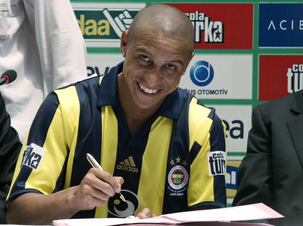 Brazilian defender Roberto Carlos signs...