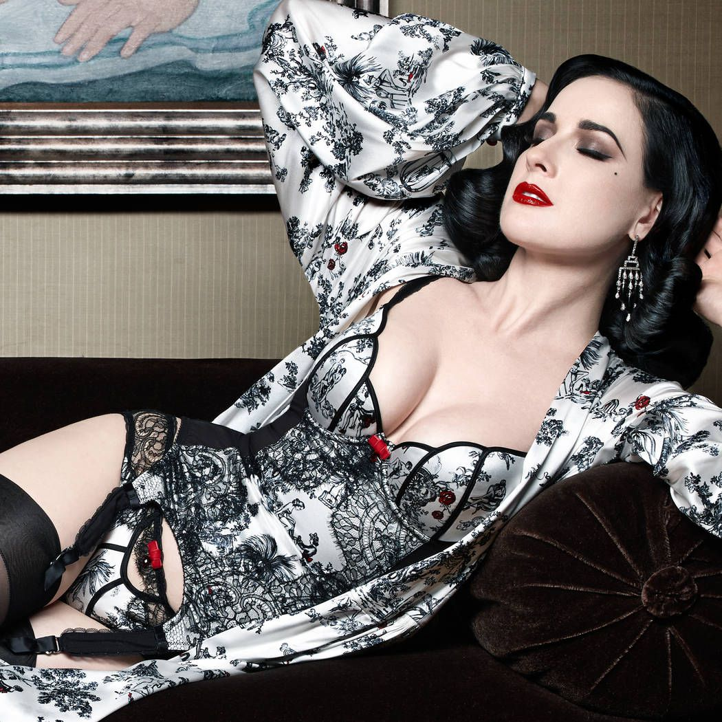 Dita Von Teese poses in her XXXtian collection