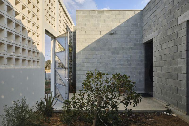 Outdoor area with concrete walls and shrubs.