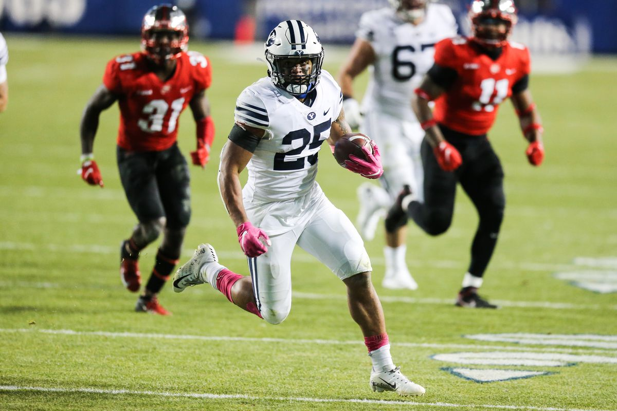 Brigham Young Cougars running back Tyler Allgeier (25) caries the ball into the end zone for a touchdown, but the play was then called back due to a holding foul, during an NCAA football game at LaVell Edwards Stadium in Provo on Saturday, Oct. 31, 2020.