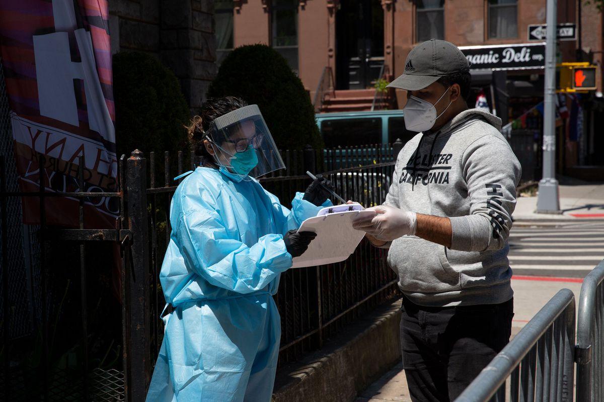 A man signs up for free coronavirus testing at Bethany Baptist Church in Bed-Stuy, Brooklyn, May 13, 2020.