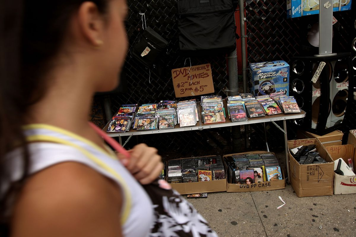 Pirated DVDs on Canal Street in New York on July 16, 2007