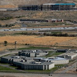 The Utah State Prison in Draper is pictured on Tuesday, Sept. 17, 2019. Technology company Pluralsight's new headquarters, which are under construction, are pictured in the background.