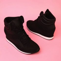 """The fashion sneaker is huge this season and with good reason. It'll update any outfit, from a simple jeans-and-tunic combo to a minidress. $44.90 at <a href=""""http://www.shopakira.com/products/patton-02-sneaker-wedge-in-black-pu.html"""">Akira</a>"""