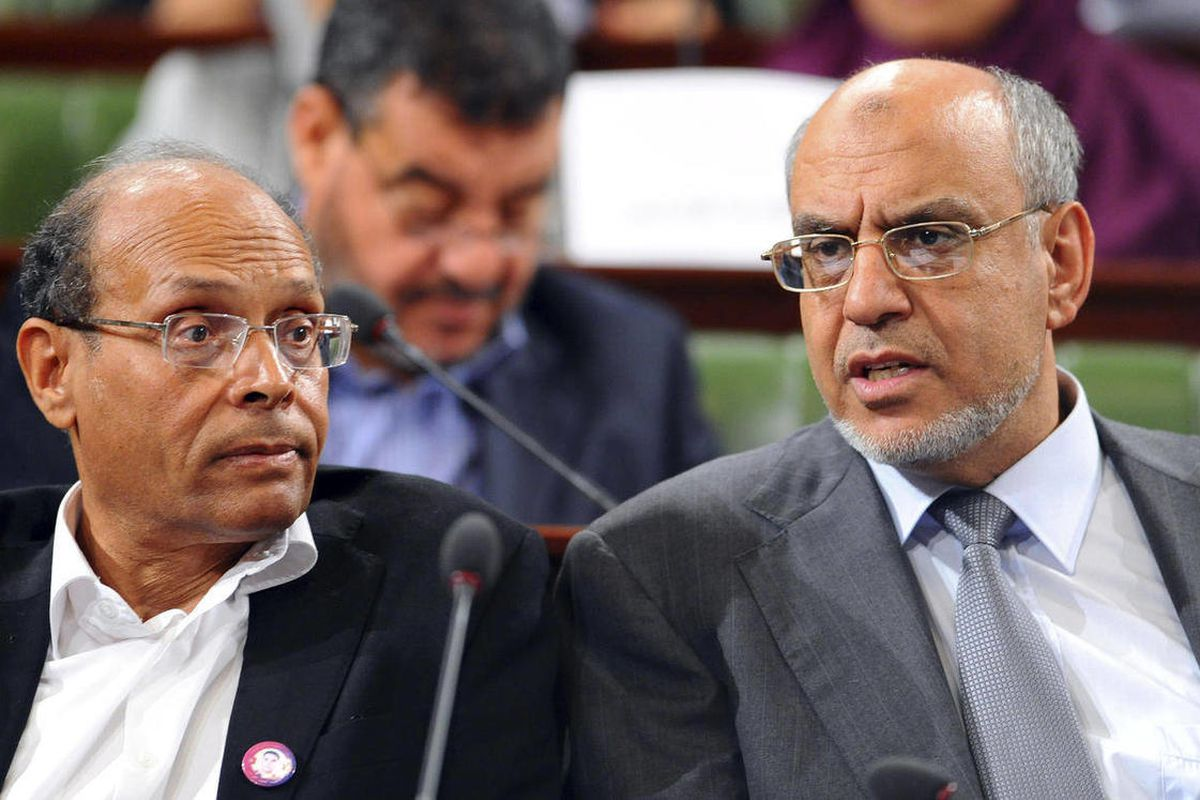 FILE -  President of Tunisia who is a veteran rights activist Moncef Marzouki, left, and Prime Minister Hamadi Jebali, right, attend a session at the newly elected assembly, near Tunis, in this Wednesday, Nov. 23, 2011 file photo, as they began the yearlo