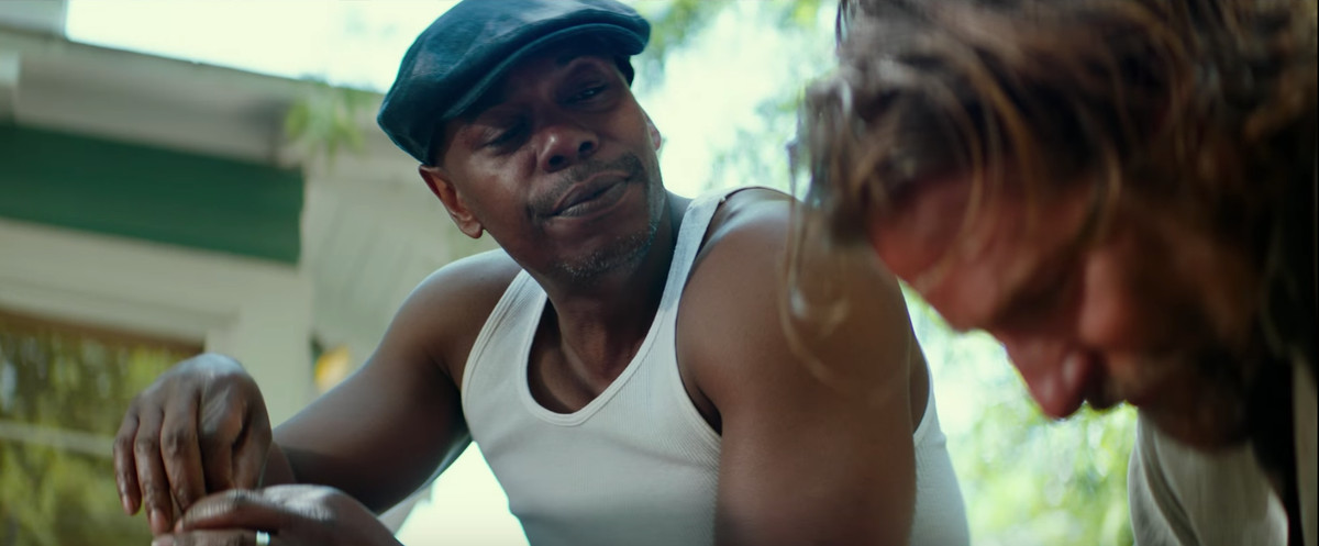 Dave Chappelle wearing a white tank top