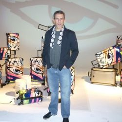 """Artist, John """"Crash"""" Matos giving us his Blue Steel in front of his Tumi collab collection"""