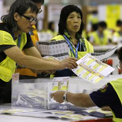 Electoral officers count ballots at the central ballot counting station after legislative elections in Hong Kong, Monday, Sept. 10, 2012. Hong Kong voters cast ballots in legislative elections Sunday that will help determine the eventual shape of full democracy that Beijing has promised the former British colony.