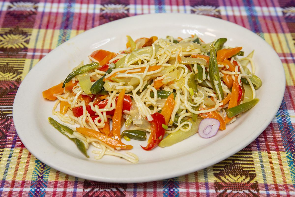 A plate of noodles with chayote peppers and carrots