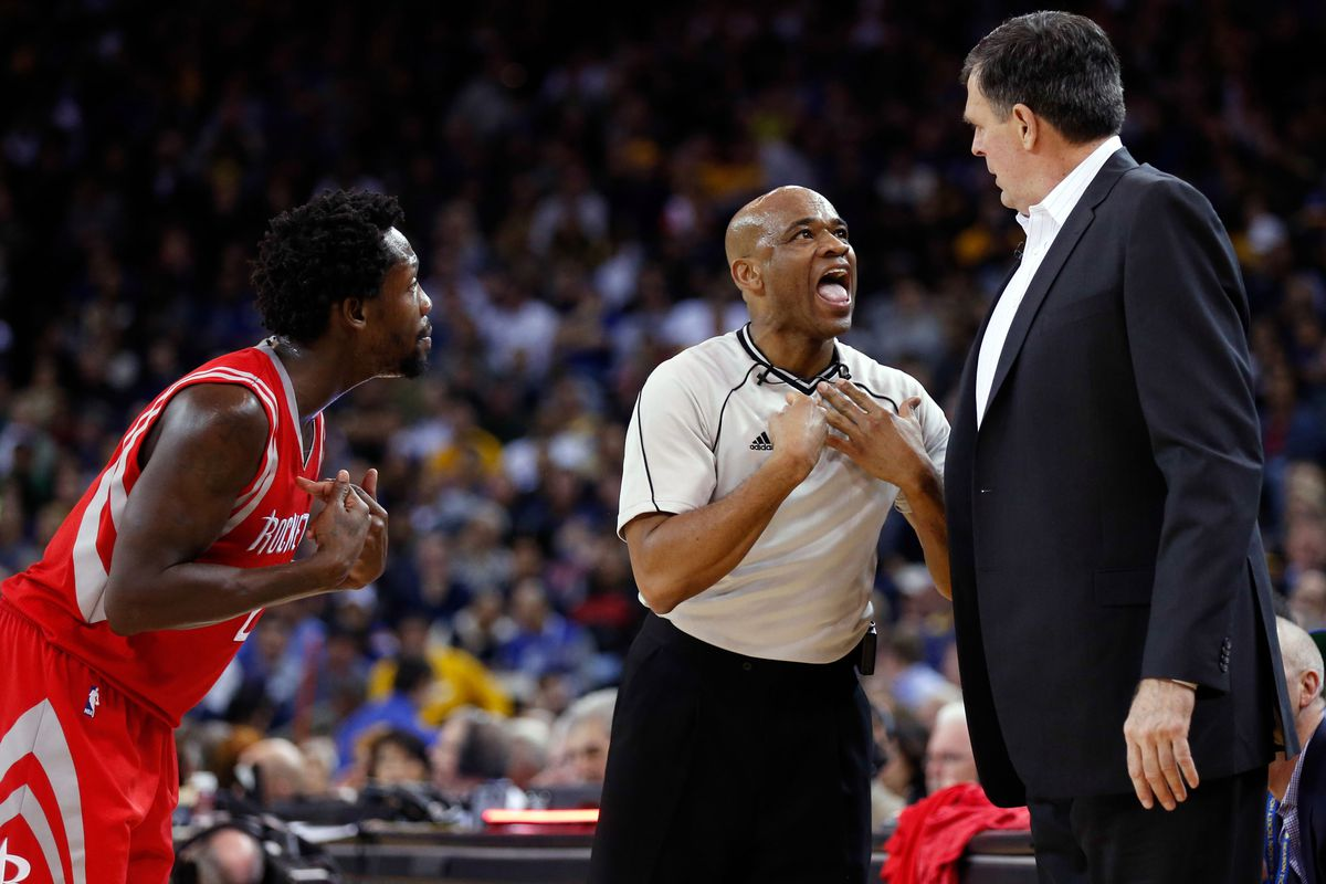 Referee Tre Maddox (M) is seemly telling Rockets head coach Kevin McHale (R) what he already knows, that his team choked,