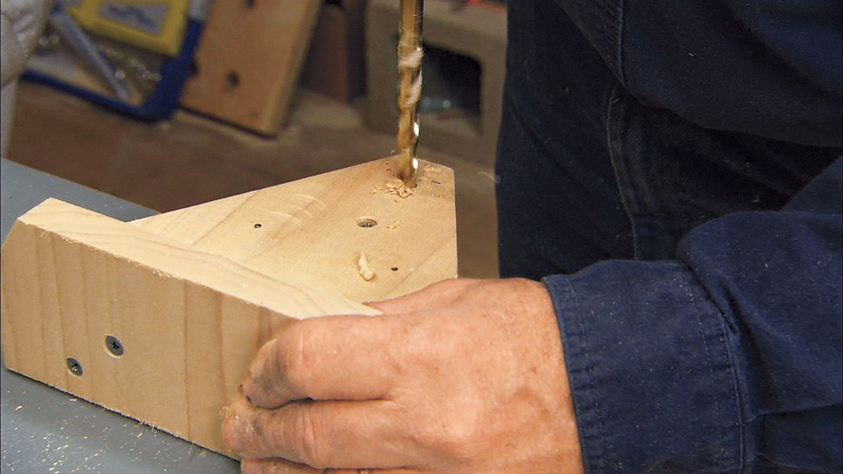 Drilling holes for bolts.