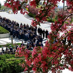 BYU students walk towards the Marriott Center doors for Spring Commencement Exercises at BYU Thursday, April 19, 2012.