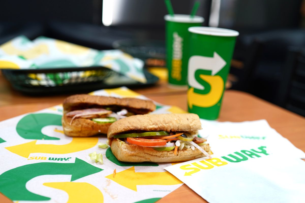 Two sandwiches on Subway branded paper