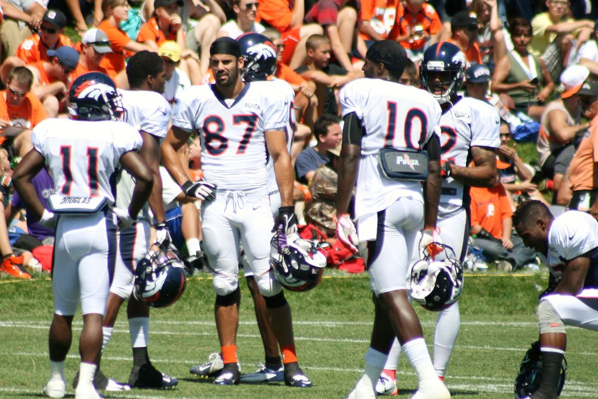 Denver Broncos wide receivers Trindon Holliday, Demaryius Thomas, Eric Decker, and Gerrell Robinson talk during training camp on July 31,2013.