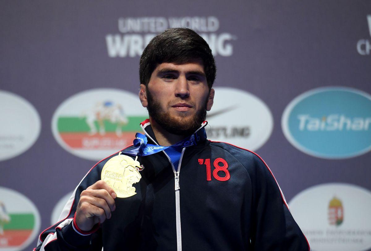 Zavir Uguev celebrates a gold medal win at the 2018 World Wrestling Championships.