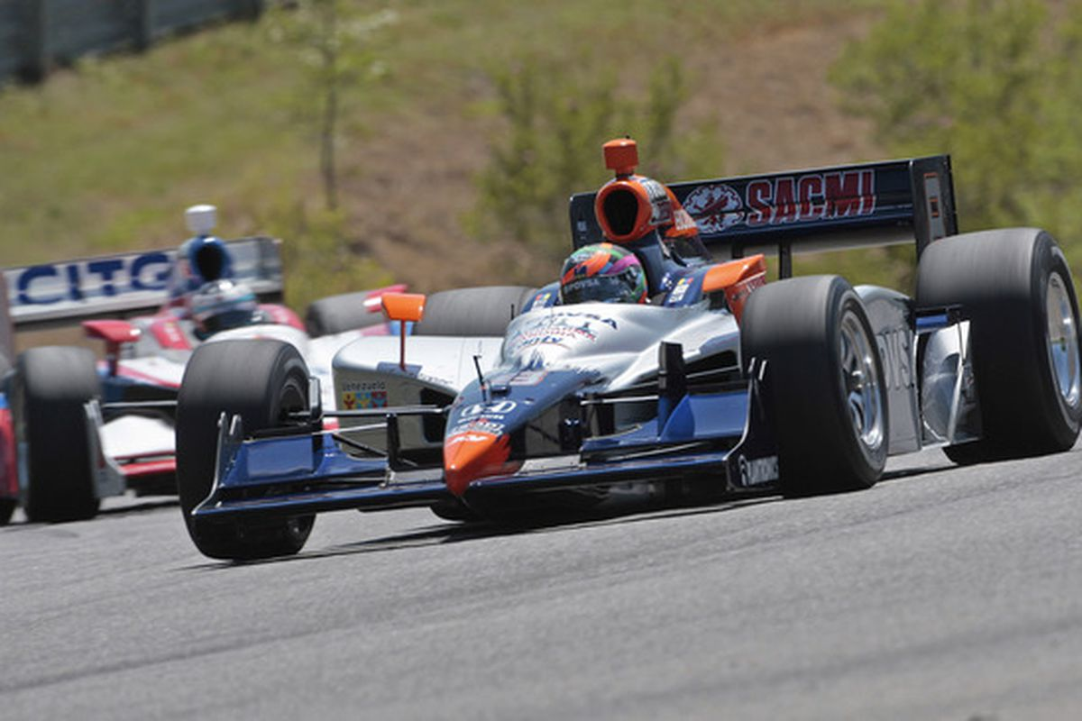 E.J. Viso (8) puts a lap on Milka Duno (18) at Barber Motorsports Park on Sunday, April 11, 2010 (Photo by Dave Martin/Getty Images)