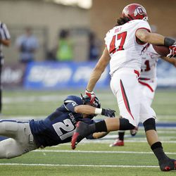 Utah Utes tight end David Rolf (47) runs by Utah State Aggies safety Brian Suite (21)  in Logan  Friday, Sept. 7, 2012.