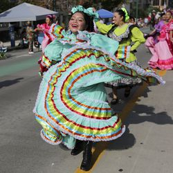 Arely Guarno,s with the Mexican Consulate, dances during the Days of '47 Parade in Salt Lake City on Friday, July 23, 2021.